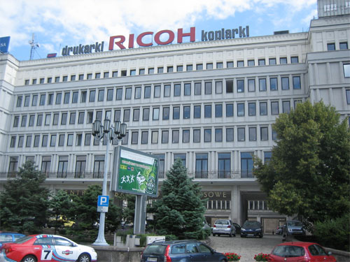 Soviet-era building with RICOH sign on top, Warsaw